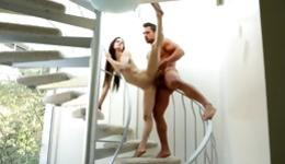 Skinny long haired beauty is getting fucked on the stairs and blows dick