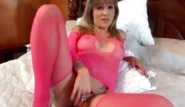 Playful blonde solo masturbating her tight anal with a long black dildo