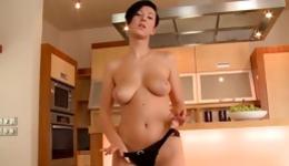 Amazing brunette with short hair playing with a red long dildo