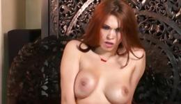 Watch on red haired sweetheart who is posing and fingering her twat