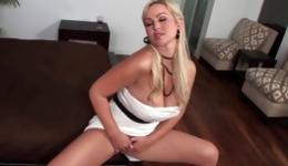 Perfect blonde exposing her boobs and is stimulating it with a dildo